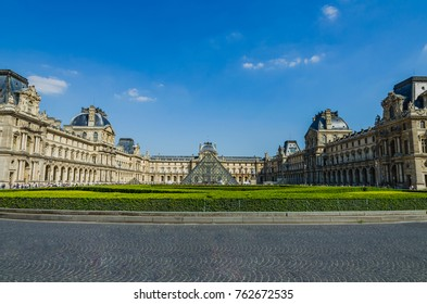 Paris, France - May 17, 2014: The glass pyramid and the Louvre Museum.