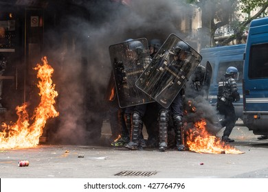 Paris, FRANCE - MAY 17, 2016 : French police, anti-riot squad,surrounded by fire during the massive protest over the labor law reforms.