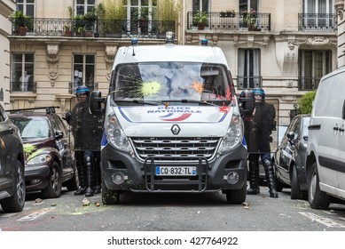 Paris, FRANCE - MAY 17, 2016 : French police, anti-riot squad, monitoring crowd to contain people during the massive protest over the labor law reforms.