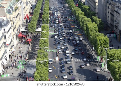 Paris, France - May 17, 2018: Traffic of cars on the Champs Elysees in Paris, France on May 17, 2018