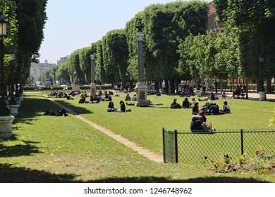 Paris, France - May 17, 2018: Students on the grass lawn at the Luxembourg gardens in Paris, France on May 17, 2018