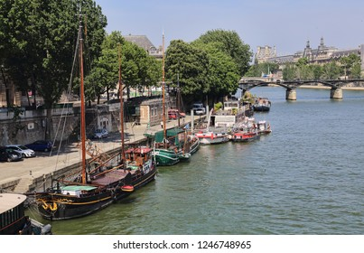 Paris, France - May 17, 2018: Historical boats on the bank of the Seine in Paris, France on May 17, 2018