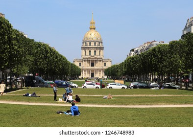 Paris, France - May 17, 2018: People on the grass lawn in front of the tomb of Napoleon at les Invalides, now the Army Museum in Paris, France on May 17, 2018