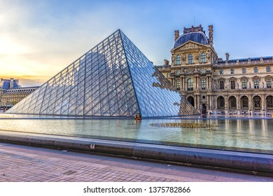 PARIS, FRANCE - MAY 18, 2014: View Pyramid at courtyard of Paris Louvre Museum at sunset. Louvre Museum is one of the largest and most visited museums worldwide.