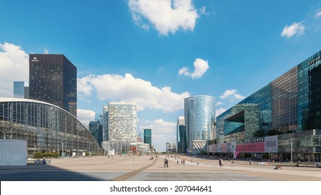 PARIS, FRANCE - MAY 18, 2014: People walking in the central square of La Defense, a major business district of Paris. La Defense welcomes 8.4 million visitors each year.