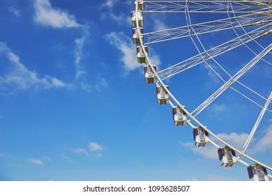 PARIS, FRANCE - MAY 18, 2018: Gondolas of Parisian Ferris Wheel over the blue sky. La Grande Roue de Paris is about to leave the Place de la Concorde and offers free rides to Parisians