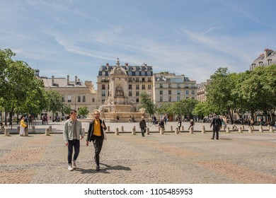 Paris / France - May 18, 2018: People in the plaza in front of the beautiful and historic Church of Saint-Sulpice, in the Saint-Germain des Pres neighborhood, known for its many historic sites.