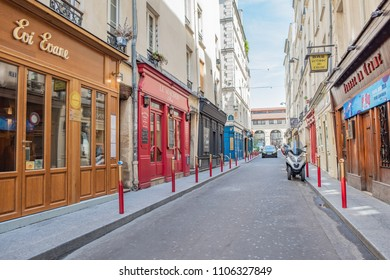 Paris / France - May 18, 2018: View of the beautiful, quaint, colorful streets of the famous and popular Saint-Germain des Pres neighborhood, in Paris' Left Bank, when they are empty.