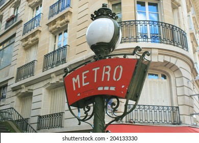 PARIS, FRANCE - MAY 19. 2014: Classic Metro Sign Showing the Entrance to the Paris Subway System.