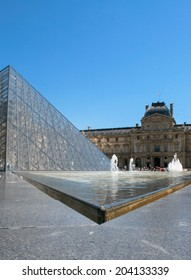PARIS, FRANCE - MAY 19. 2014: Courtyard of the Louvre Museum, Glass Pyramid and Fountain.