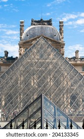 PARIS, FRANCE - MAY 19. 2014: Aligned Glass Pyramids of the Louvre Museum in Front of the Palace Facade.
