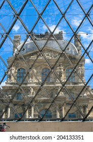 PARIS, FRANCE - MAY 19. 2014: Facade of the Louvre Museum Palace through Glass Pyramid