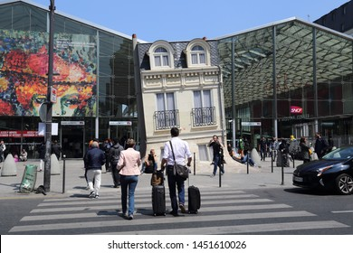 Paris, France - May 19, 2018: People with luggage at the Gare du Nord railway station in Paris, France on May 19, 2018