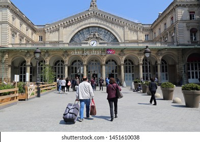 Paris, France - May 19, 2018: Tourists with bags walk to Gare de l'Est railway station in Paris, France on May 19, 2018