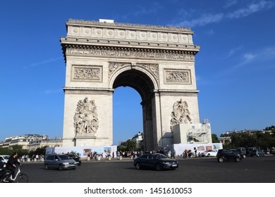 Paris, France - May 19, 2018: Traffic of cars around the Arc de Triomphe in Paris, France on May 19, 2018