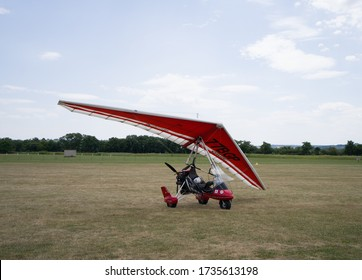 PARIS, FRANCE - MAY 19, 2020: Microlight Ultralight aircraft red trike