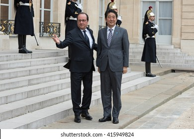 PARIS, FRANCE - MAY 2, 2016 : The french President Francois Hollande welcoming the Prime Minister of Japan Shinzo Abe at Elysee Place during a working visit about the summit of G7 in japan.