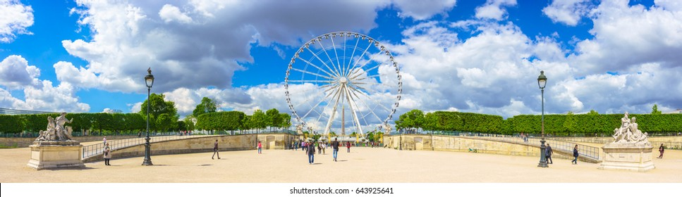 Paris, France - May 2, 2017: Panorama view of The Big Wheel at Place de la Concorde view from Tuileries Garden with the crowd and cloudy sky in a background on May 02, 2017, in Paris, France.