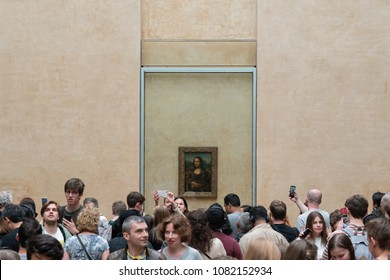 "PARIS, FRANCE - MAY 2: Unidentified Visitors Visit Leonardo DaVinci's Painting ""Mona Lisa"" at the Louvre Museum on May 2,2018"