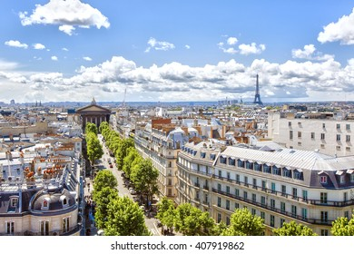 Paris, France - May 20, 2015: view to the Rue Tronchet , Church of St. Mary Magdalene  and Eiffel tower