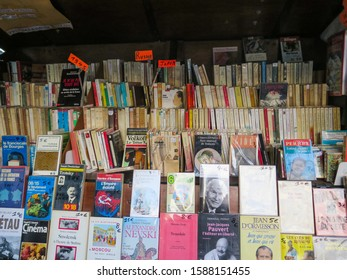 Paris, France - May 2016: Used books on a shelf in a famous bookstall in the Seine riverside
