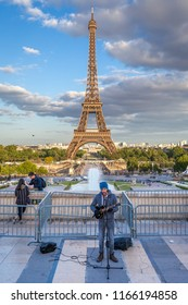Paris, France - May 2018: A busker performs at Trocadero Square, with the Eiffel Tower in the background
