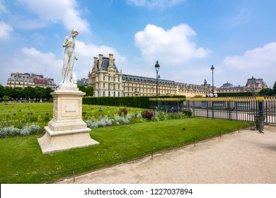 Paris, France - May 2018: Statue of Nymph in Tuileries garden and Louvre palace