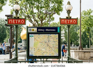 PARIS, FRANCE - MAY 21, 2016: Alma-Marceau Paris metro station entrance with map of Paris and vintage lamp post in central historic part of - transportation public