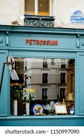 PARIS, FRANCE - MAY 21, 2016: Blue Facade of Petrossian fish caviar restaurant Paris in central Paris