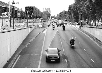 PARIS, FRANCE - MAY 21, 2016: Cars on the Quai des Tuileries street in central Paris with heavy traffic and Louvre museum in the background - black and white photo