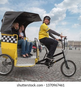 Paris, France - May 22, 2012: Man driving in bicycle taxi