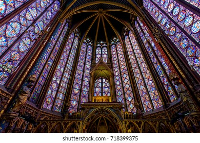 PARIS, FRANCE - MAY 22, 2017: Stained Glass Interior in The Sainte-Chapelle in Paris, France. The Sainte-Chapelle is a royal chapel in the Gothic style, within the medieval Palais de la Cite