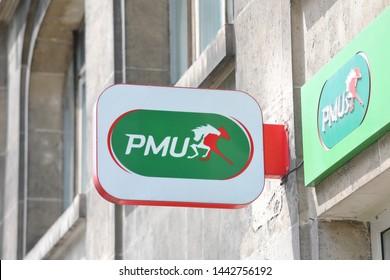PARIS FRANCE - MAY 23, 2019: PMU horse race betting sign Paris France