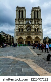 Paris, France - May 24, 2014: Notre dame facade in Paris France in a cloudy day