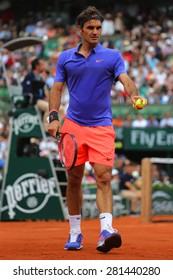 PARIS, FRANCE- MAY 24, 2015: Seventeen times Grand Slam champion Roger Federer during first round match at Roland Garros 2015 in Paris, France