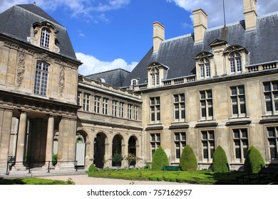 PARIS, FRANCE - MAY 24, 2015: Courtyard with the beautiful gardens of Carnavalet Museum. The museum was opened in 1880 and is dedicated to the history of Paris, from its origins to the present day