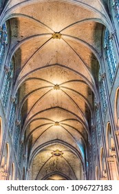 PARIS, FRANCE - MAY 24, 2016: Interiors of the Notre Dame de Paris Cathedral in Paris, France. Notre Dame construction began in the year 1163 and was completed in the year 1345.