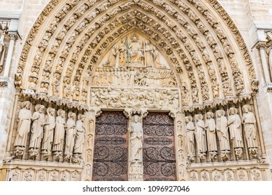 PARIS, FRANCE - MAY 24, 2016: Facade saint statues of the Notre Dame de Paris Cathedral in Paris, France. Notre Dame construction began in the year 1163 and was completed in the year 1345.