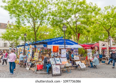 PARIS, FRANCE - MAY 24, 2016: Street view of the Place du Tertre in Montmartre area,  Paris, France. Paris is the capital and most populous city of France.
