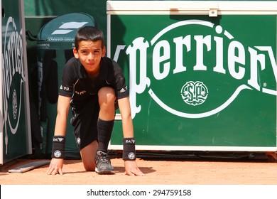 PARIS, FRANCE- MAY 25, 2015: Ball boy during match at Roland Garros 2015 in Paris, France