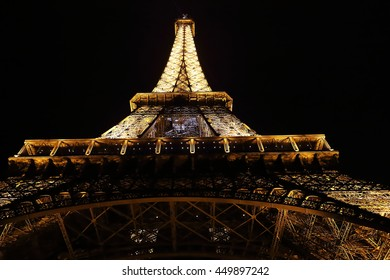 PARIS, FRANCE - MAY 25, 2015: This is view of the top of the Eiffel tower in the night illumination of its backlight.