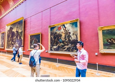 PARIS, FRANCE - MAY 25, 2016: Many people appreciate art works in the Louvre Museum in Paris, France. The Louvre is the world's largest museum and a historic monument in Paris, France.
