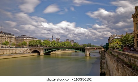 Paris, France - May 25, 2018: Notre dame bridge and Haussmann period buildings viewed from river Seine