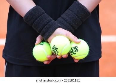 PARIS, FRANCE- MAY 26, 2015 :Ball boy holding Babolat tennis balls at Roland Garros 2015 in Paris, France