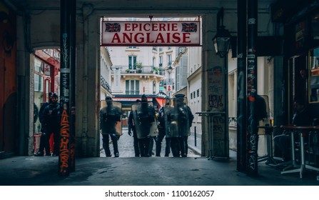 Paris, France - May 26, 2018: French riot police block an exit in the centre of Paris while protestors express their anger against French President Macro's government, among other issues
