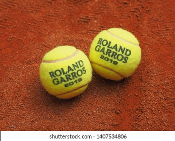 Paris, France - May 26, 2019: Two Roland Garros Grand Slam Tennis ball on clay court surface