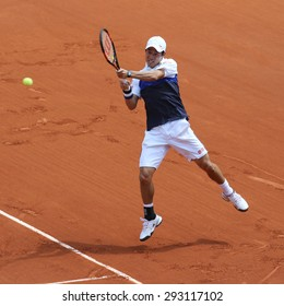 PARIS, FRANCE- MAY 27, 2015: Professional tennis player Kei Nishikori of Japan in action during his second round match at Roland Garros 2015 in Paris, France