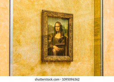 PARIS, FRANCE - MAY 27, 2016: Mona Lisa is protected by bulletproof glasses in the Louvre Museum in Paris, France. The Louvre is the world's largest museum and a historic monument in Paris, France.