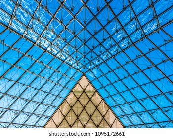 PARIS, FRANCE - MAY 27, 2016: Louvre Pyramid of the Louvre Museum in Paris, France. The Louvre Museum is the world's largest museum and a historic monument in Paris, France.