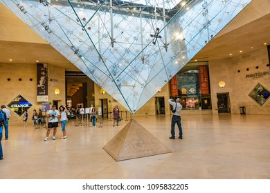 PARIS, FRANCE - MAY 27, 2016: The Inverted Pyramid in Paris, France. The Inverted Pyramid is a skylight constructed in the Carrousel du Louvre shopping mall in front of the Louvre Museum in France.
